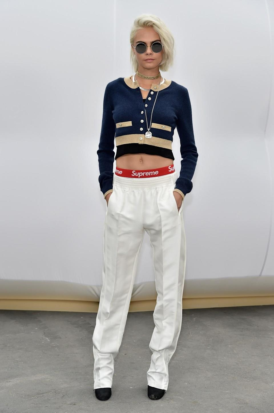 <p>Cara Delevingne showed her face in tailored Chanel.<i>[Photo: Getty]</i> </p>