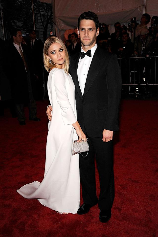 "Ashley Olsen looked all grown up as she posed in a dramatic white gown from her twin sister Mary-Kate's label with her boyfriend, Justin Bartha. We're loving her sleek bob! Larry Busacca/<a href=""http://www.gettyimages.com/"" target=""new"">GettyImages.com</a> - May 4, 2009"