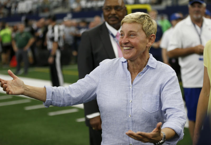 Entertainer Ellen DeGeneres walks on the field during warmups before an NFL football game between the Green Bay Packers and the Dallas Cowboys in Arlington, Texas, Sunday, Oct. 6, 2019. (AP Photo/Ron Jenkins)