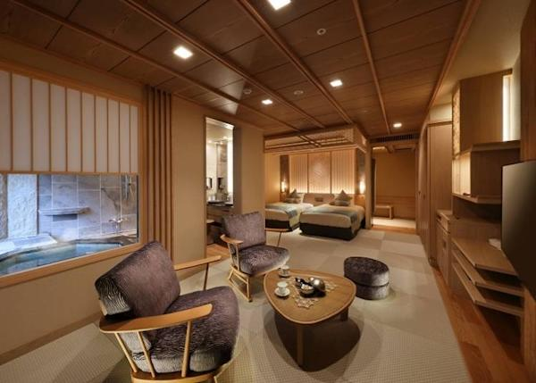 This is a Japanese and Western guest room with an attached landscape bath on the top floor of Shūhōkan wing. The room comes adorned with Tochigi's traditional woodcraft lattices known as Kanuma-Kumiko.