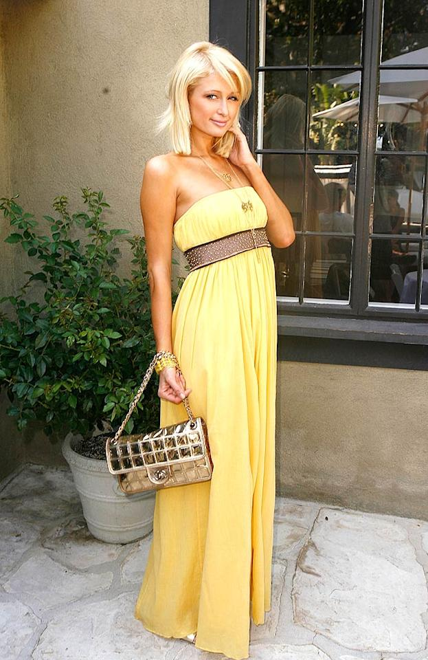 "She may be a tad too tan, but Paris Hilton looks absolutely yummy in her strapless yellow dress. Jeff Vespa/<a href=""http://www.wireimage.com"" target=""new"">WireImage.com</a> - July 26, 2008"