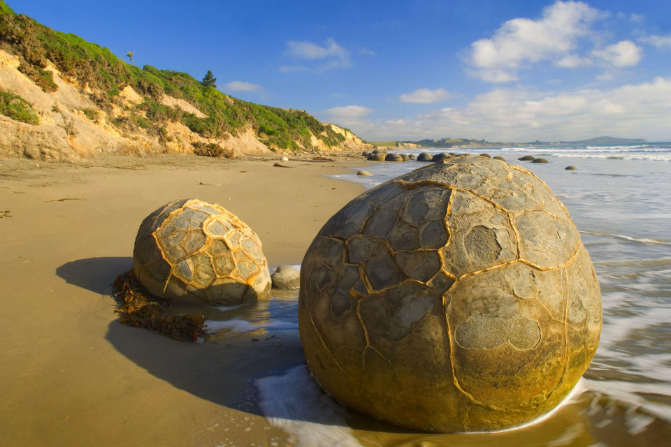 <b>The Moeraki Boulders of New Zealand</b> - The gigantic boulders started forming on the ocean floor and can now been seen sitting mysteriously on the coastline thanks to centuries of erosion. (Alexandra Sailer/Ardea/Caters News)