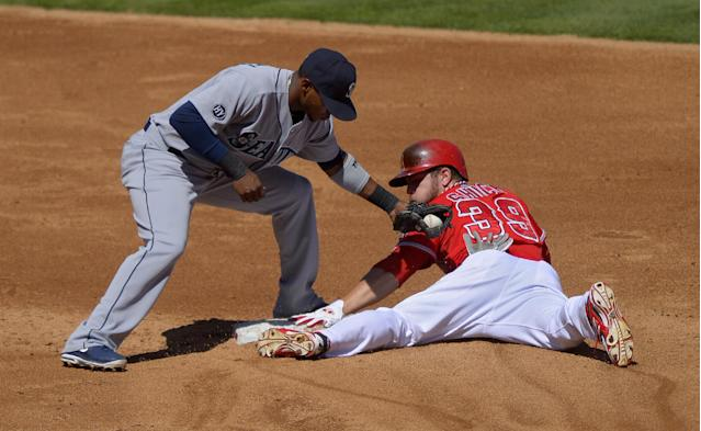 Los Angeles Angels' J.B. Shuck, right, steals second under the tag of Seattle Mariners second baseman Carlos Triunfel during the third inning of a baseball game on Sunday, Sept. 22, 2013, in Anaheim, Calif. (AP Photo/Mark J. Terrill)