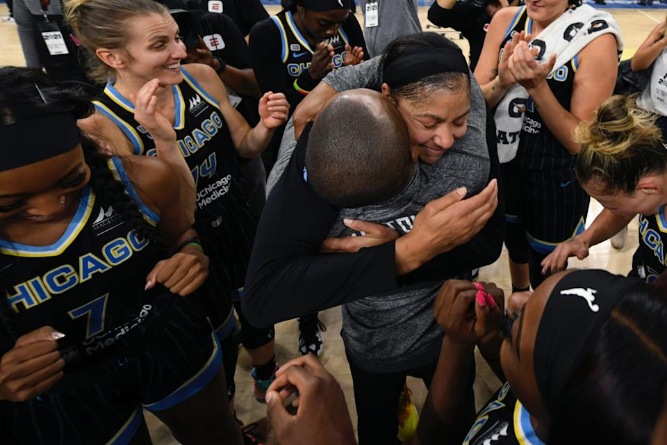 Candace Parker (center) hugs Sky coach James Wade as the team celebrates clinching a spot in the 2021 WNBA Finals.