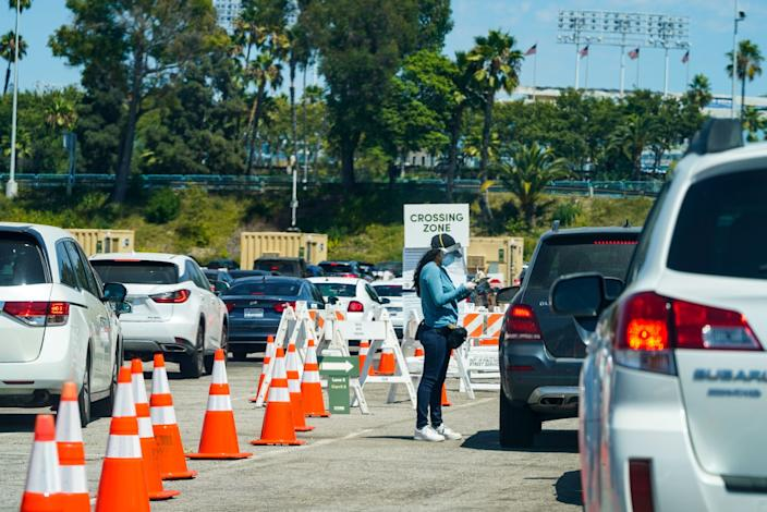 Cars line up at a COVID19 test site at Dodger Stadium.
