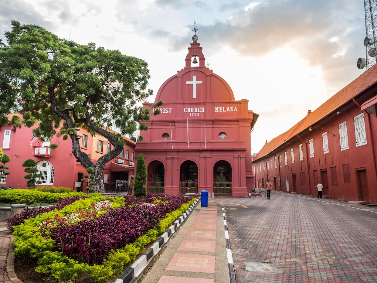 """While driving to the Cameron Highlands, Nick and Rachel stop in the town of Malacca to see the """"distinctive crimson-hued facade of Christ Church, built by the Dutch."""""""