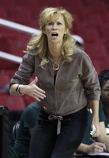 Michigan State head coach Suzy Merchant directs her players during the first half of a first-round game against Marist in the women's NCAA college basketball tournament in College Park, Md., Saturday, March 23, 2013. Michigan State won 55-47. (AP Photo/Patrick Semansky)