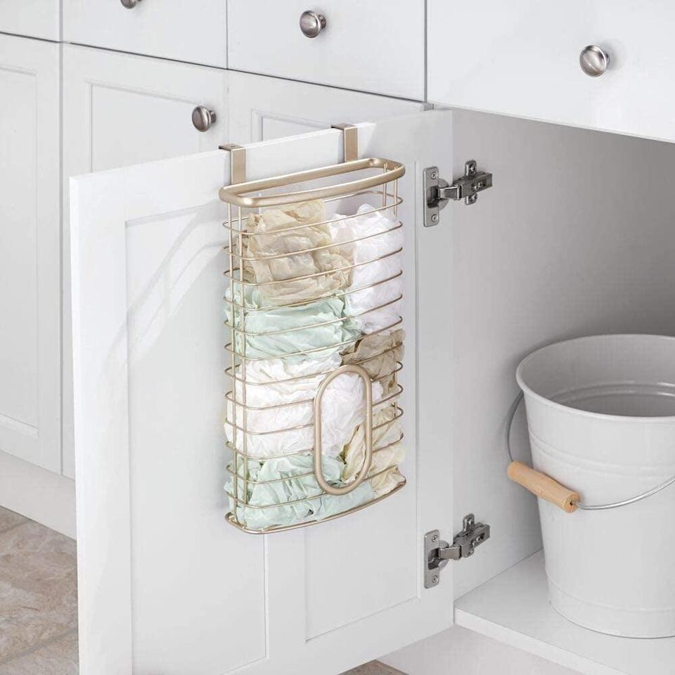 <p>If your cabinets always have eco-friendly plastic bags floating around, then get the <span>MDesign Metal Over Cabinet Organizer</span> ($20, originally $26). All you have to do is hang it over your pantry door.</p>
