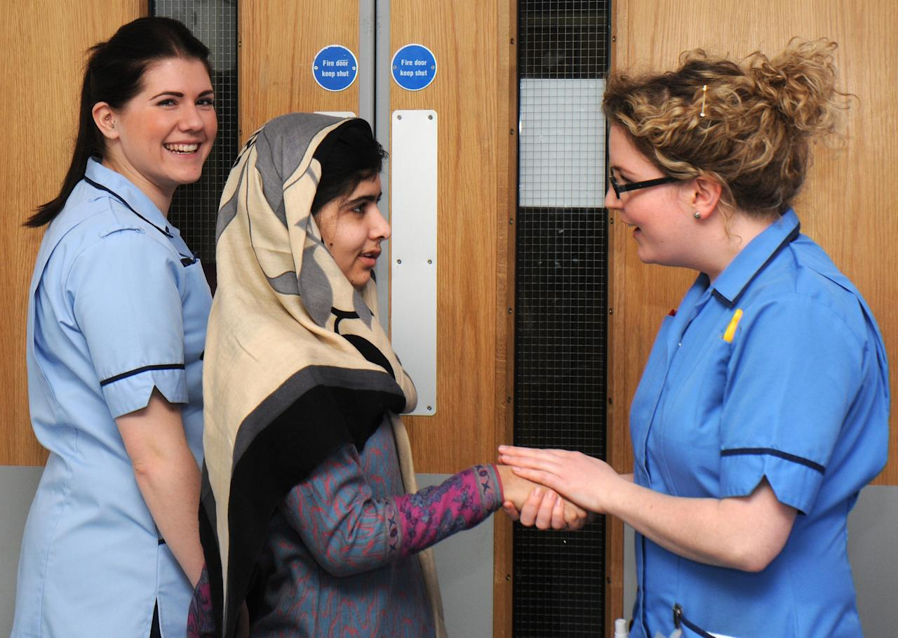 BIRMINGHAM, UNITED KINGDOM - JANUARY 04:  In this handout image supplied by Queen Elizabeth Hospital, Malala Yousafzai says goodbye to nurses as she leaves the Queen Elizabeth Hospital on January 04, 2013 in Birmingham, United Kingdom. The Pakistani schoolgirl activist who was shot in the head by Taliban gunmen has been discharged today from Queen Elizabeth Hospital in Birmingham as an inpatient. (Photo by Queen Elizabeth Hospital Via Getty Images)
