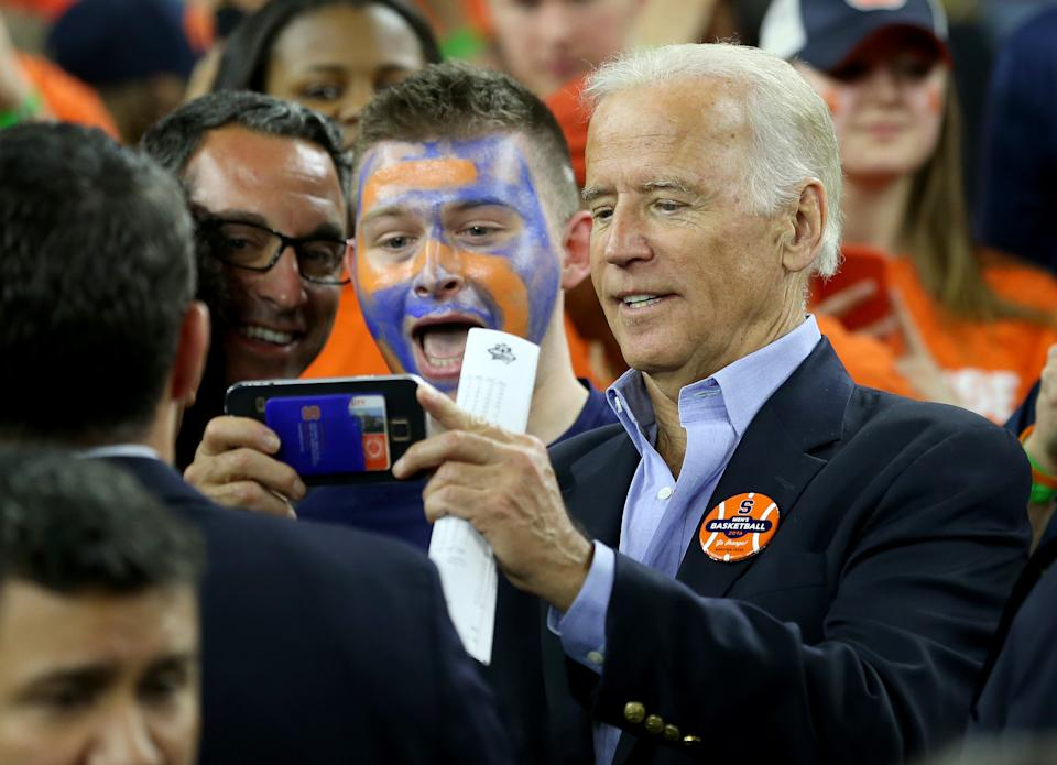HOUSTON, TEXAS - APRIL 02:  Vice President Joe Biden poses for a picture with Syracuse Orange fans prior to the NCAA Men's Final Four Semifinal between the North Carolina Tar Heels and the Syracuse Orange at NRG Stadium on April 2, 2016 in Houston, Texas.  (Photo by Streeter Lecka/Getty Images)