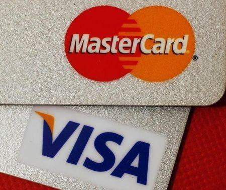 Mastercard visa to cut fees for canadian merchants government says mastercard and visa credit cards are seen in this illustrative photograph taken in hong kong reheart Images
