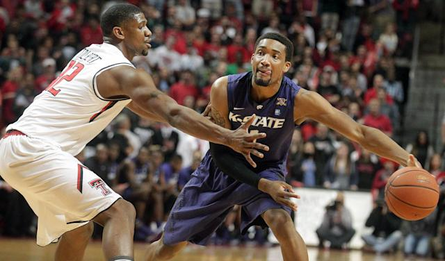 Kansas State's Shane Southwell (1) looks to pass around Texas Tech's Jordan Tolbert during an NCAA college basketball game in Lubbock, Texas, Tuesday, Feb, 25, 2014. (AP Photo/Lubbock Avalanche-Journal, Stephen Spillman)