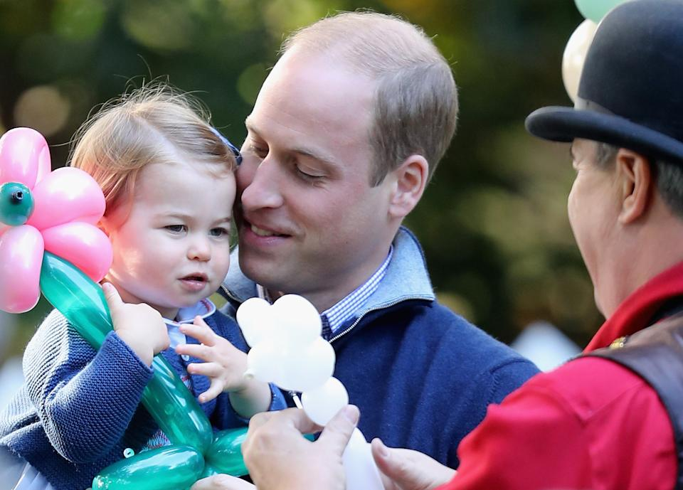 VICTORIA, BC - SEPTEMBER 29: Prince William, Duke of Cambridge and Princess Charlotte of Cambridge at a children's party for Military families during the Royal Tour of Canada on September 29, 2016 in Carcross, Canada. Prince William, Duke of Cambridge, Catherine, Duchess of Cambridge, Prince George and Princess Charlotte are visiting Canada as part of an eight day visit to the country taking in areas such as Bella Bella, Whitehorse and Kelowna  (Photo by Chris Jackson - Pool/Getty Images)