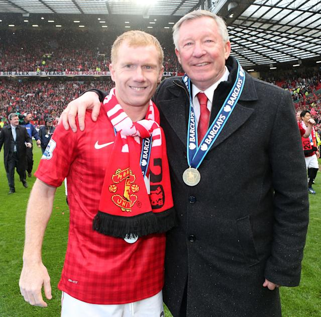 MANCHESTER, ENGLAND - MAY 12: Manager Sir Alex Ferguson of Manchester United celebrates with Paul Scholes after the Barclays Premier League match between Manchester United and Swansea City at Old Trafford on May 12, 2013 in Manchester, England. (Photo by Matthew Peters/Man Utd via Getty Images)