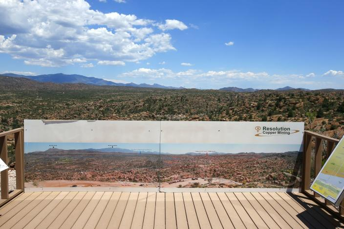 FILE - This June 15, 2015, file photo shows in the distance, part of the Resolution Copper Mining land-swap project in Superior, Ariz. A group of Apaches who have tried for years to reverse a land swap in Arizona that will make way for one of the largest and deepest copper mines in the U.S. sued the federal government Tuesday, Jan. 12, 2021. Apache Stronghold argues in the lawsuit filed in U.S. District Court in Arizona that the U.S. Forest Service cannot legally transfer land to international mining company Rio Tinto in exchange for eight parcels the company owns around Arizona. (AP Photo/Ross D. Franklin, File)