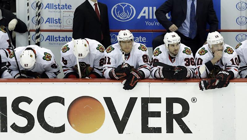 From left to right, Chicago Blackhawks Michael Frolik (67), Bryan Bickell (29), Marian Hossa (81), Dave Bolland (36) and Patrick Sharp (10) watch from the bench during the second period in Game 4 of the Western Conference semifinals against the Detroit Red Wings in the NHL hockey Stanley Cup playoffs in Detroit, Thursday, May 23, 2013. Detroit won 2-0. (AP Photo/Paul Sancya)