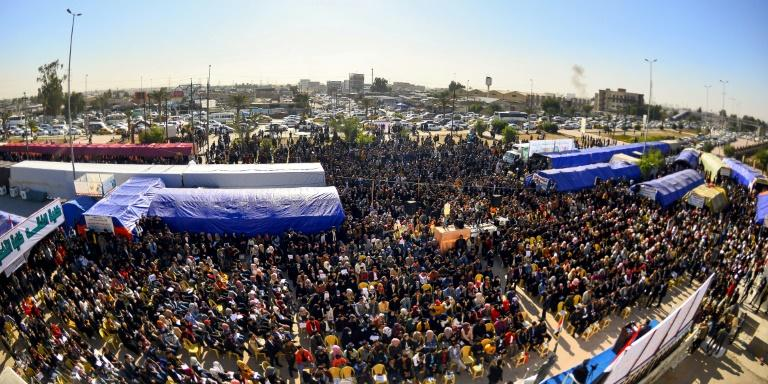 Protesters gather outside Kufa University in central Iraq on Sunday