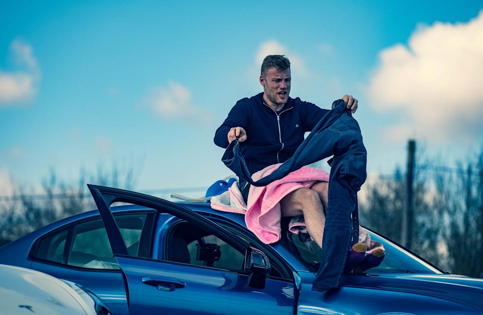 Freddie Flintoff gets changed on the roof of a car in 'Top Gear'BBC Studios/Lee Brimble