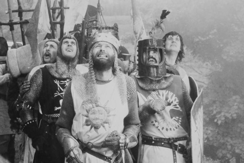 British comedians Eric Idle, John Cleese, Graham Chapman, Terry Jones and Michael Palin in a scene from 'Monthy Python and the Holy Grail', directed by Terry Gilliam and Terry Jones, 1975 (Photo by Warner Bros./Hulton Archive/Getty Images)
