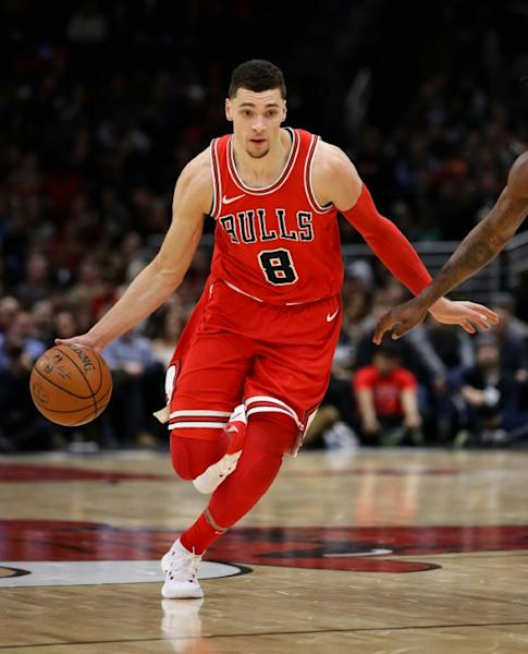 Zach LaVine scored 14 points in his first game in 11 months as the host Chicago Bulls edged the Detroit Pistons 107-105