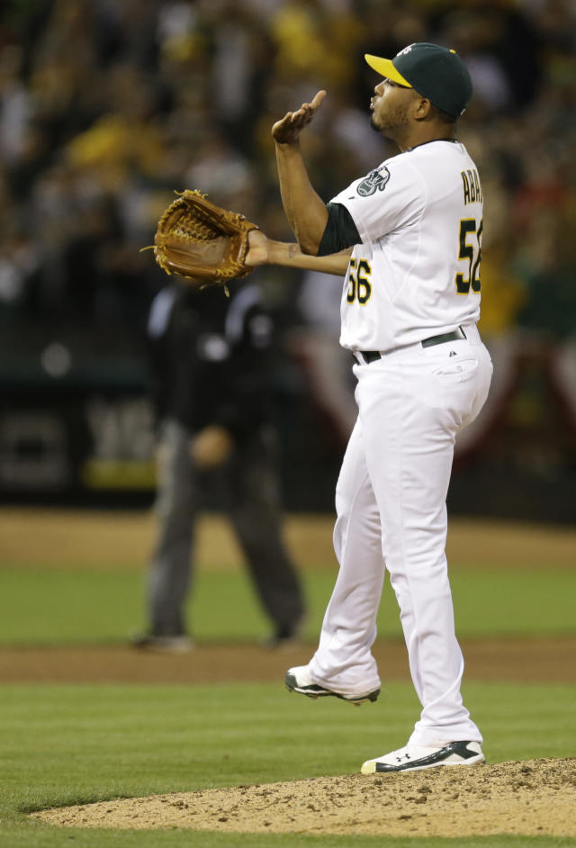 Oakland Athletics' Fernando Abad celebrates after their 5-1 win over the Toronto Blue Jays in a baseball game Saturday, July 5, 2014, in Oakland, Calif. (AP Photo/Ben Margot)
