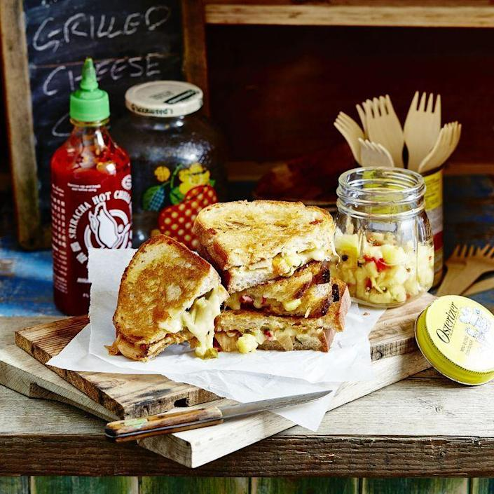 """<p>For those who can't get enough kimchi, this grilled cheese recipe will hit the spot. </p><p><em><strong>Get the recipe at <a href=""""https://www.goodhousekeeping.com/uk/food/recipes/a32314737/pickled-pineapple-kimchi-grilled-cheese/"""" rel=""""nofollow noopener"""" target=""""_blank"""" data-ylk=""""slk:Good Housekeeping."""" class=""""link rapid-noclick-resp"""">Good Housekeeping.</a></strong></em></p>"""