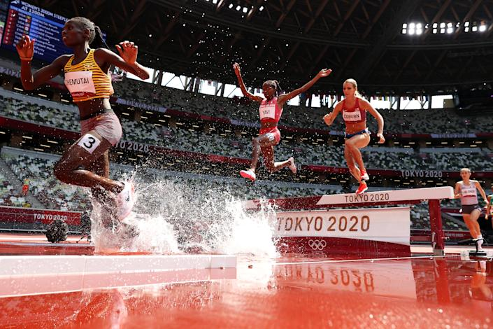 <p>Peruth Chemutai of Team Uganda, Winfred Mutile Yavi of Team Bahrain and Emma Coburn of Team United States compete in round one of the Women's 3000m Steeplechase heats on day nine of the Tokyo 2020 Olympic Games at Olympic Stadium on August 01, 2021 in Tokyo, Japan. (Photo by Christian Petersen/Getty Images)</p>