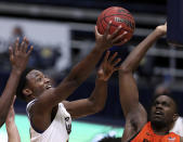 California guard Jalen Celestine, left, shoots against Oregon State forward Dearon Tucker, right, during the second half of an NCAA college basketball game in Berkeley, Calif., Thursday, Feb. 25, 2021. (AP Photo/Jed Jacobsohn)