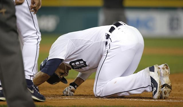 Detroit Tigers' Victor Martinez goes to the ground following a single in the ninth inning during Game 3 of the American League baseball championship series against the Boston Red Sox Tuesday, Oct. 15, 2013, in Detroit. (AP Photo/Paul Sancya)