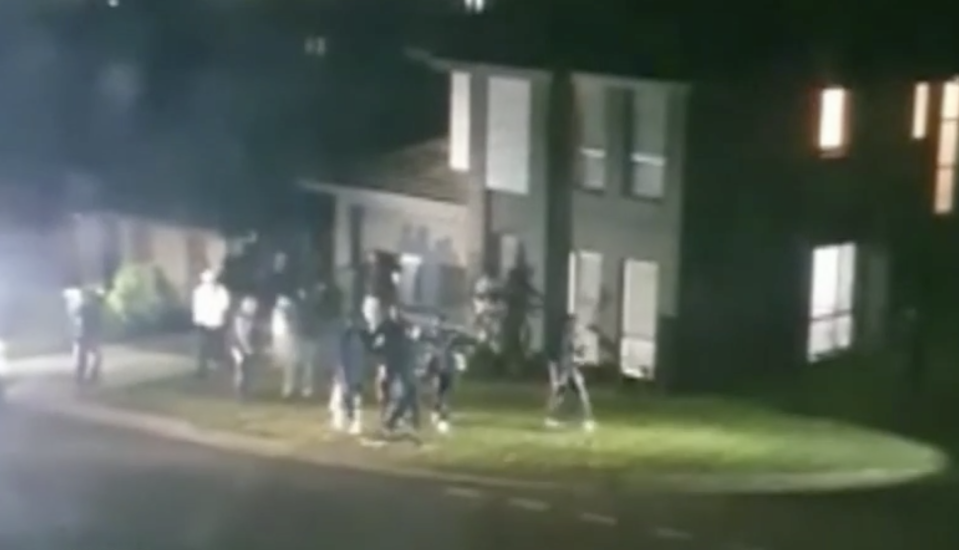 Pictured are dozens of people at a house party in Schofields.