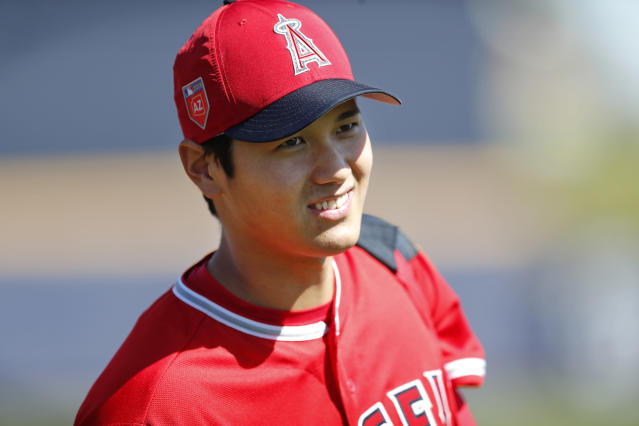 Los Angeles Angels' Shohei Ohtani walks on the field before a spring training baseball game against the San Diego Padres, Monday, Feb. 26, 2018, in Peoria, Ariz. (AP Photo/Charlie Neibergall)