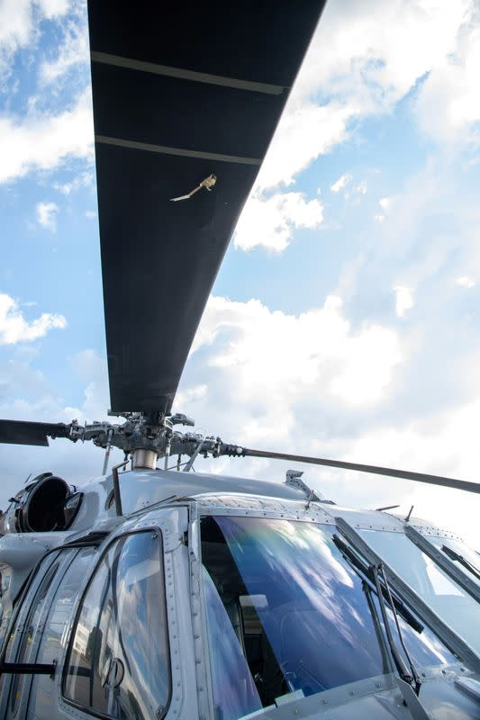 The mark of a projectile impact is seen on the propeller of a helicopter where Colombian President Ivan Duque was traveling, after, according to the authorities, suffered an attack during an overflight in Cucuta