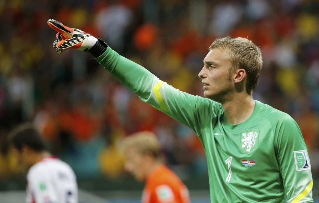 Goalkeeper Jasper Cillessen of the Netherlands signals his players during the 2014 World Cup quarter-finals between Costa Rica and the Netherlands at the Fonte Nova arena in Salvador July 5, 2014. REUTERS/Sergio Moraes (BRAZIL - Tags: SOCCER SPORT WORLD CUP)