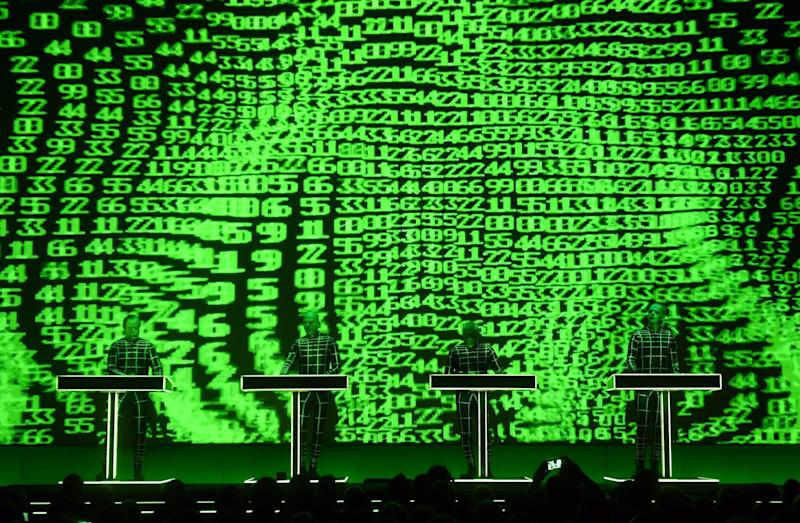 "German electronic music band Kraftwerk (""power station"") performs in front of a 3D video installation: ULI DECK/DPA/AFP via Getty Images"