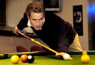 <p>William playing pool with friends at a bar in St Andrews during his final year. He lived with Kate during a lot of his time there. (PA Images)</p>