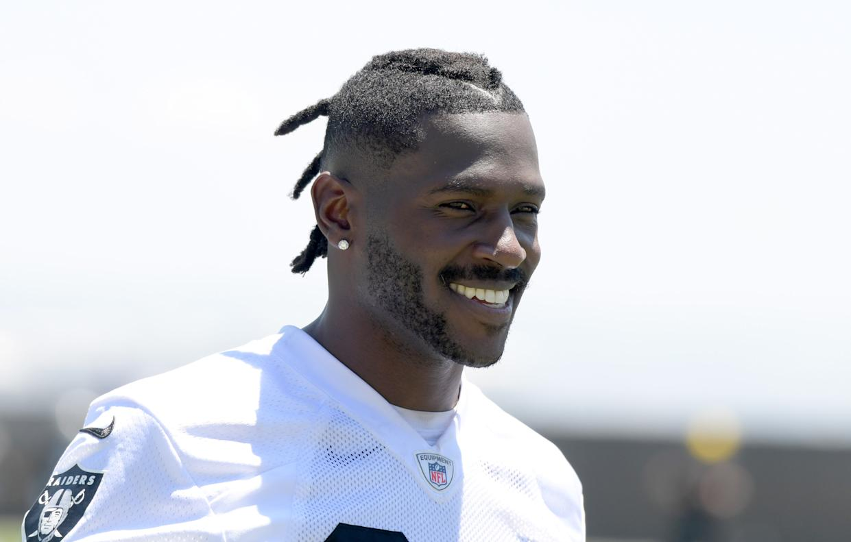 Of course Antonio Brown made a show of his arrival to Raiders camp. (Reuters)