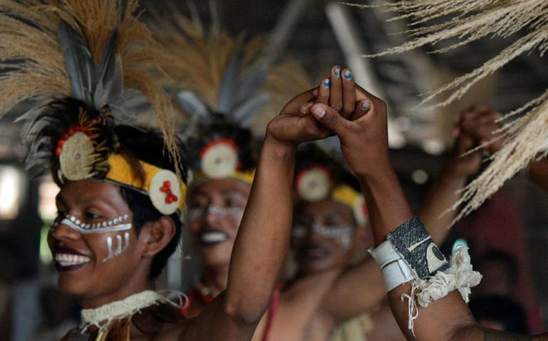Gay indigenous men perform in Colombia's community of Nazareth, which has become a place where LGBT members can build a life