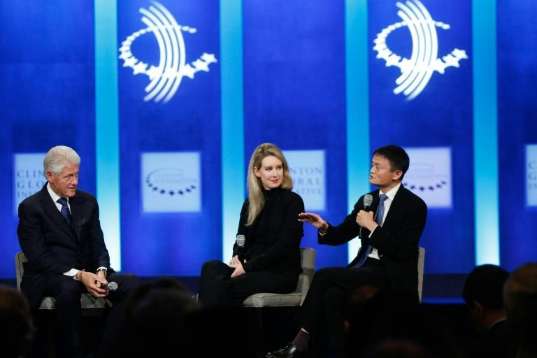 Holmes, seen here with Chinese entreprenur Jack Ma and former US president Bill Clinton was an object of fascination way beyond the Bro culture of Silicon Valley start-ups (AFP/JP Yim)