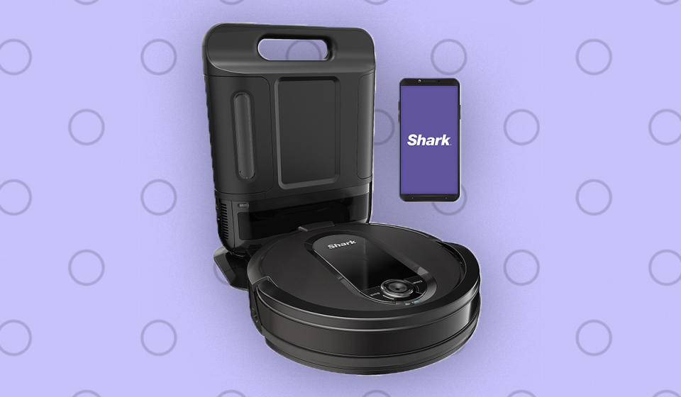 The Shark IQ robot vac automatically empties its own dust bin into the bagless charging base. (Photo: QVC)