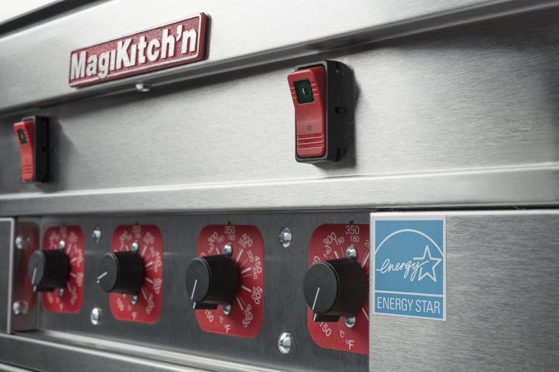 Silver and red kitchen equipment labeled MagiKitch'n.