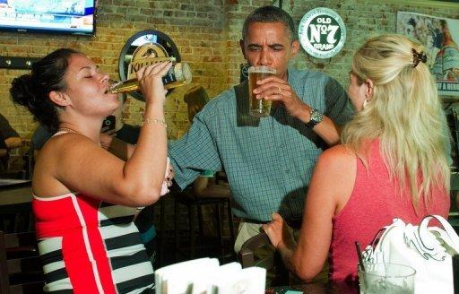 <p>US President Barack Obama (C) shares a beer with customers at Ziggy's Pub and Restaurant in Amherst, Ohio, July 5. Obama heralded his first re-election campaign bus tour with a new trade blast at China and fresh accusations his White House foe Mitt Romney helped send US jobs abroad</p>