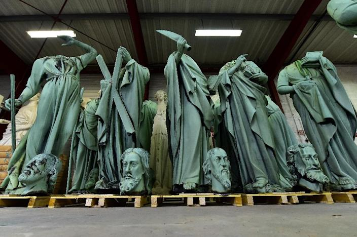 Statues which sat around the spire of the Notre-Dame Cathedral were removed before the fire struck (AFP Photo/GEORGES GOBET)