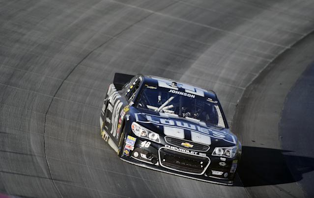 Jimmie Johnson drives his car during a NASCAR Sprint Cup Series auto race on Sunday, Sept. 29, 2013, at Dover International Speedway in Dover, Del. Johnson won the race. (AP Photo/Nick Wass)