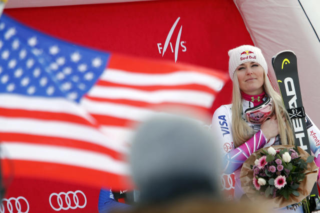First placed United States' Lindsay Vonn listens to the national anthem at the end of an alpine ski, women's world Cup downhill race, in Garmisch Partenkirchen, Germany, Saturday Feb. 3, 2018. (AP Photo/Gabriele Facciotti)