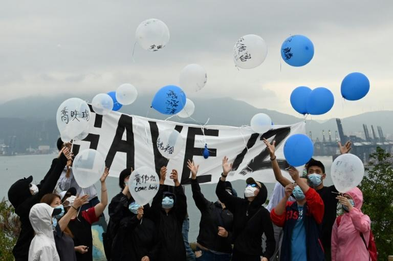 Relatives and some supporters released balloons carrying messages to their loved ones
