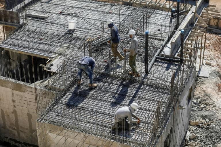 Palestinian labourers are responsible for building many of the houses in Israeli settlements, such as here in Kerem Reim in the West Bank (AFP Photo/MENAHEM KAHANA)