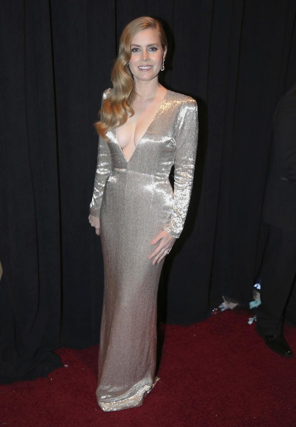 <p>Amy Adams didn't walk the red carpet — but she should have! Her shimmering Tom Ford gown made her look like she was glowing. (Photo: AP) </p>