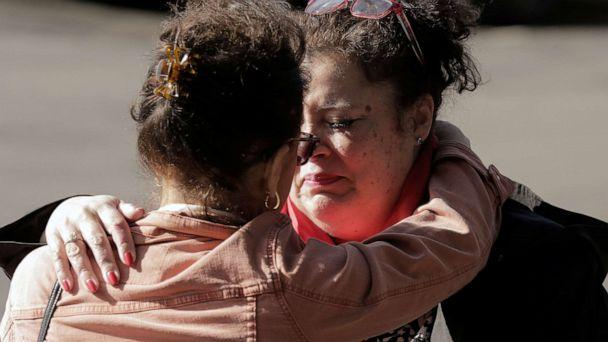 PHOTO: Carmen Gray, left, hugs her sister, Bridget Parkhill, after discussing concerns their mother, a resident at the Life Care Center of Kirkland, which has several confirmed coronavirus cases, in Kirkland, Wash., March 4, 2020. (David Ryder/Reuters)