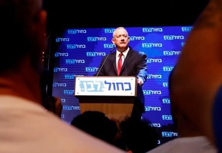 Blue and White party leader Benny Gantz speaks at the party's headquarters following the announcement of exit polls during Israel's parliamentary election in Tel Aviv