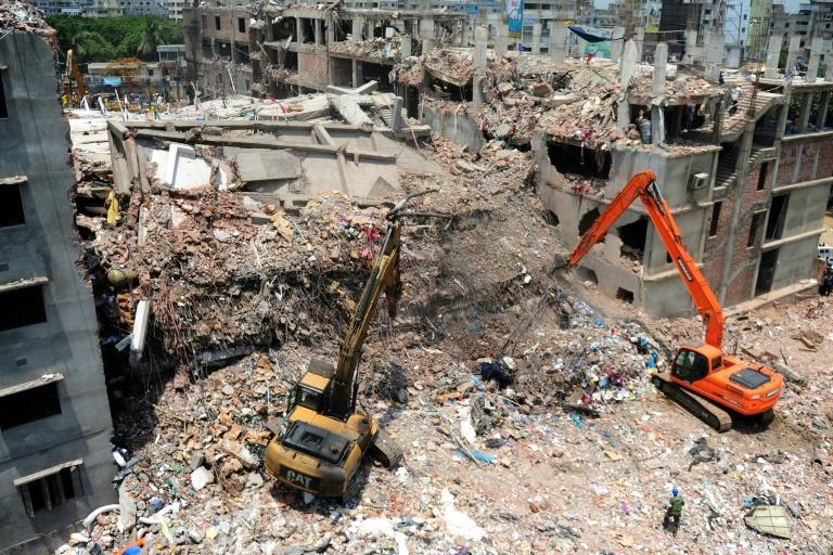 Rescuers use diggers to move debris a week after the Rana Plaza building collapsed, killing over 1,130 clothing factory workers outside of Bangladesh's capital Dhaka
